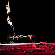 "A moment of the Mobile Circus show: Camille and Omar taking refuge on the rope, after a ""bomb explosion"" simulation"