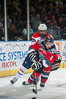 KELOWNA, CANADA - NOVEMBER 7: Colten Martin #8 of Kelowna Rockets makes a pass while being back checked by Riley Whittingham #25 of Spokane Chiefs on November 7, 2014 at Prospera Place in Kelowna, British Columbia, Canada.  (Photo by Marissa Baecker/Shoot the Breeze)  *** Local Caption *** Colten Martin; Riley Whittingham;