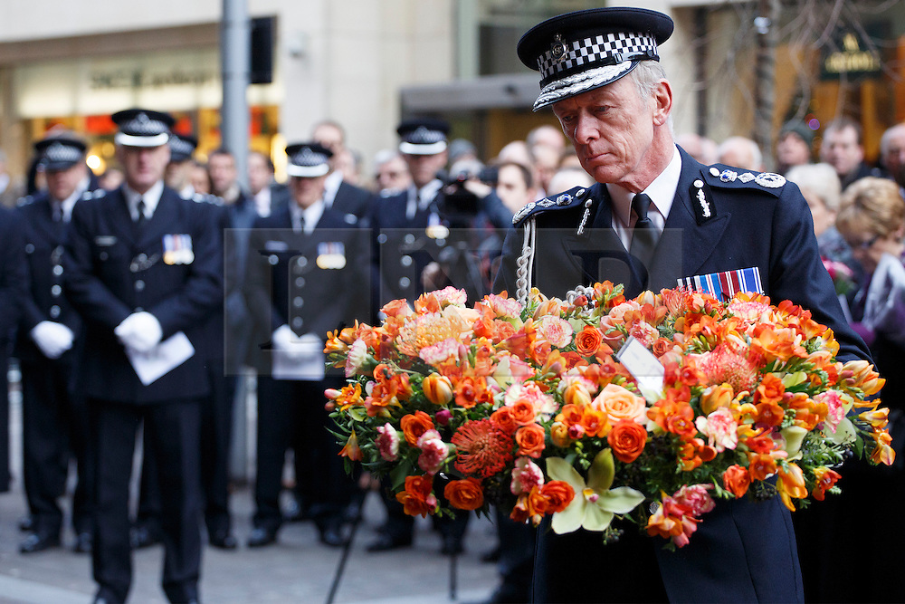 © licensed to London News Pictures. London, UK 17/12/2013. Sir Bernard Hogan-Howe lays a wreath to commemorate an IRA bomb attack on Harrods which killed six people, including three Metropolitan Police officers on December 17, 1983. The 30th anniversary is marked by members of Metropolitan Police, relatives and friends of victims and Harrods staff at a special service outside the world-famous department store in London on Tuesday, December 17, 2013. Photo credit: Tolga Akmen/LNP