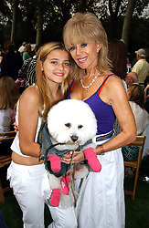 SALLY FARMILOE with her daughter JADE FARMILOE and their dog Pasha at the Macmillan Cancer Relief Dog Day held at the Royal Hospital Chelsea South Grounds, London on 6th July 2004.