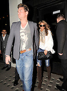 10.MAR.2011 LONDON<br /> <br /> KATIE PRICE AND NEW MAN LEANDRO PENNA LEAVING KATIE BEST FRIENDS PHIL TURNER AND GARY COCKERILL'S HOUSE BEFORE HEADING TO HAKKSAN RESTAURANT IN MAYFAIR WHERE THEY STAYED TILL 10.30PM AND HEADED ONTO GEM BAR IN SOHO WHERE THEY PARTIED TILL 1.30AM BEFORE CALLING IT A NIGHT AND HEADING HOME.<br /> <br /> BYLINE: EDBIMAGEARCHIVE.COM<br /> <br /> *THIS IMAGE IS STRICTLY FOR UK NEWSPAPERS AND MAGAZINES ONLY*<br /> *FOR WORLD WIDE SALES AND WEB USE PLEASE CONTACT EDBIMAGEARCHIVE - 0208 954 5968*