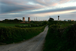 UK ENGLAND CUMBRIA SELLAFIELD 1JUN06 -General view of  BNFL's Selllafield Nuclear Reprocessing facility on the Irish Sea coast. The facility houses two types of nuclear installations. Firstly, four reactors located at Calder Hall together with their associated facilities are concerned with the generation of electricity and steam for consumption on the Sellafield site and feeding electricity into the National Grid. The second facility, comprising several hundred buildings is associated with the treatment and storage of radioactive wastes, and the reprocessing of irradiated nuclear fuel arising from the UK nuclear power programme and from overseas reactors under commercial contracts negotiated by BNFL...jre/Photo by Jiri Rezac..© Jiri Rezac 2006..Contact: +44 (0) 7050 110 417.Mobile:  +44 (0) 7801 337 683.Office:  +44 (0) 20 8968 9635..Email:   jiri@jirirezac.com.Web:    www.jirirezac.com..© All images Jiri Rezac 2006 - All rights reserved.