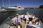 Silicon Valley, California; Tim Draper, venture capitalist, takes Airpower Communications Execs on his boat for a meeting near his office. Tim Draper, a partner in Draper, Fisher, Jurvetson, one of the leading Silicon Valley venture capital firms. Draper has been very successful lately with Internet start-up companies that have gone public. He says he was responsible for Netscape's free hotmail idea that helped the company be bought by Microsoft for several billion dollars. (1999).