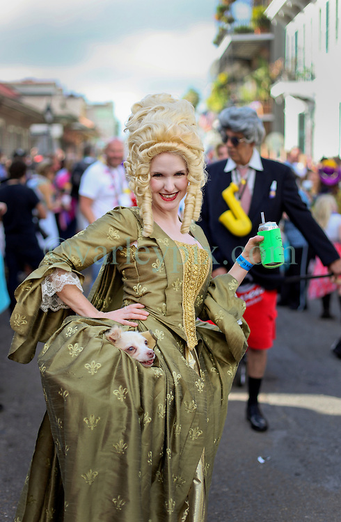 31 January 2016. New Orleans, Louisiana.<br /> Mardi Gras Dog Parade. Jenna McMullen with dog Caddo (in dress). The Mystic Krewe of Barkus winds its way around the French Quarter with dogs and their owners dressed up for this year's theme, 'From the Doghouse to the Whitehouse.' <br /> Photo©; Charlie Varley/varleypix.com