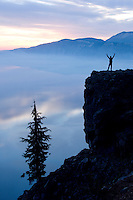 Young man hiking at Crater Lake National Park, Oregon