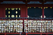 Prayer tablets hang  in front of the inner sanctuary  during the annual Reitaisai Grand Festival at Tsurugaoka Hachimangu Shrine in Kamakura, Japan on  14 Sept. 2012.  Sept 14 marks the first day of the 3-day Reitaisai festival, which starts early in the morning when shrine priests and officials perform a purification ritual in the ocean during a rite known as hamaorisai and limaxes with a display of yabusame horseback archery. Photographer: Robert Gilhooly