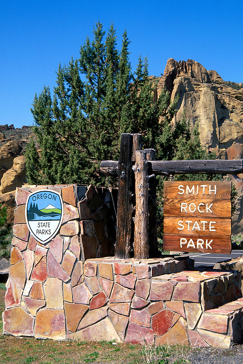 The entrance sign at Smith Rock with rock walls in background, Smith Rock State Park, Oregon