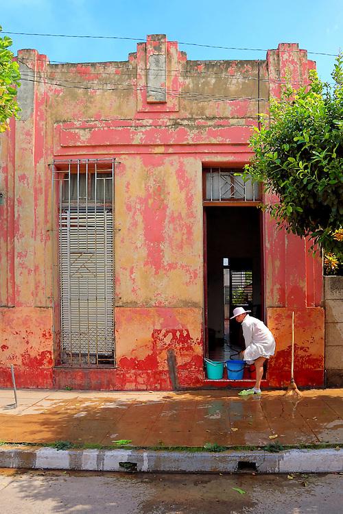 Pink house in Camaguey city, Camaguey, Cuba.
