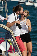 David and Tia Glover smooch on the sailboat Prime Number in San Francisco Bay