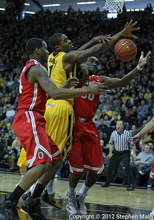 January 07, 2011: Ohio State Buckeyes guard William Buford (44), Iowa Hawkeyes forward Melsahn Basabe (1), Ohio State Buckeyes forward Evan Ravenel (30) battle for a lose ball during the the NCAA basketball game between the Ohio State Buckeyes and the Iowa Hawkeyes at Carver-Hawkeye Arena in Iowa City, Iowa on Saturday, January 7, 2012.
