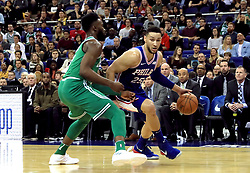 Boston Celtics' Jaylen Brown (left) and Philadelphia 76ers' Ben Simmons in action during the NBA London Game 2018 at the O2 Arena, London.