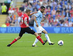 Cardiff City's Craig Bellamy battles for the ball with Manchester City's Gael Clichy  - Photo mandatory by-line: Joe Meredith/JMP - Tel: Mobile: 07966 386802 25/08/2013 - SPORT - FOOTBALL - Cardiff City Stadium - Cardiff -  Cardiff City V Manchester City - Barclays Premier League