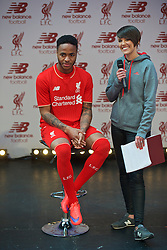 LIVERPOOL, ENGLAND - Friday, April 10, 2015: Liverpool's Raheem Sterling and LFCTV's Claire Rourke during the launch for the New Balance 2015/16 home kit at Anfield. (Pic by David Rawcliffe/Propaganda)