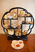 High tea display model at the Raffles Beijing Hotel, including sandwiches, cakes and scones, China