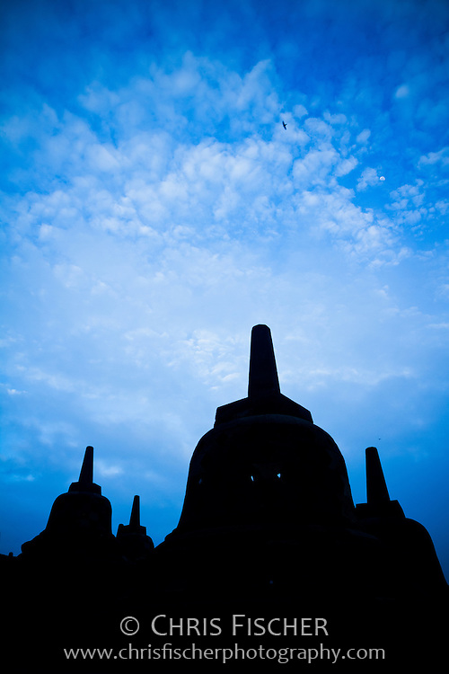 Early morning silhouette of stupas at Borobudor Temple, Central Java, Indonesia.