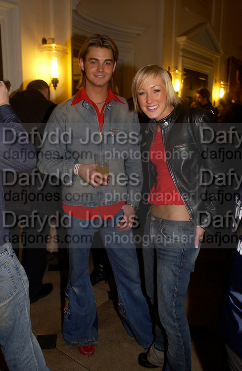 members of ' Fast Food rockers,  Lucy Meggitt ( red shirt) and Martin Rycroft ( red collar) Launch of the Somerset House Christmas Ice Rink. 26 November 2003.  © Copyright Photograph by Dafydd Jones 66 Stockwell Park Rd. London SW9 0DA Tel 020 7733 0108 www.dafjones.com