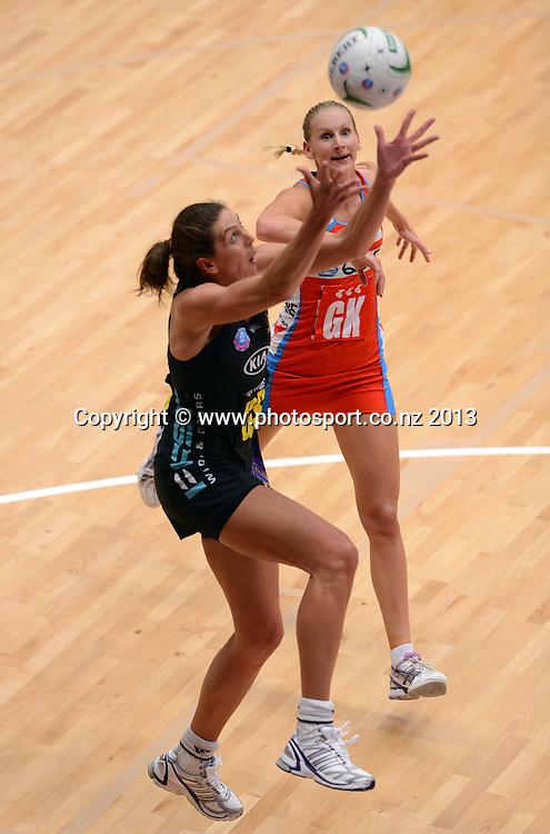 Irene Van Dyk and NSW Swift GK April Letton. ANZ Netball Championship. KIA Waikato Bay of Plenty Magic v NSW Swifts, ASB Baypark Arena, Tauranga. New Zealand. Sunday 31 March 2013. Photo: Andrew Cornaga/Photosport.co.nz
