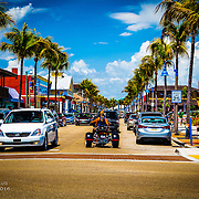 Blue skies, palm trees and a trike
