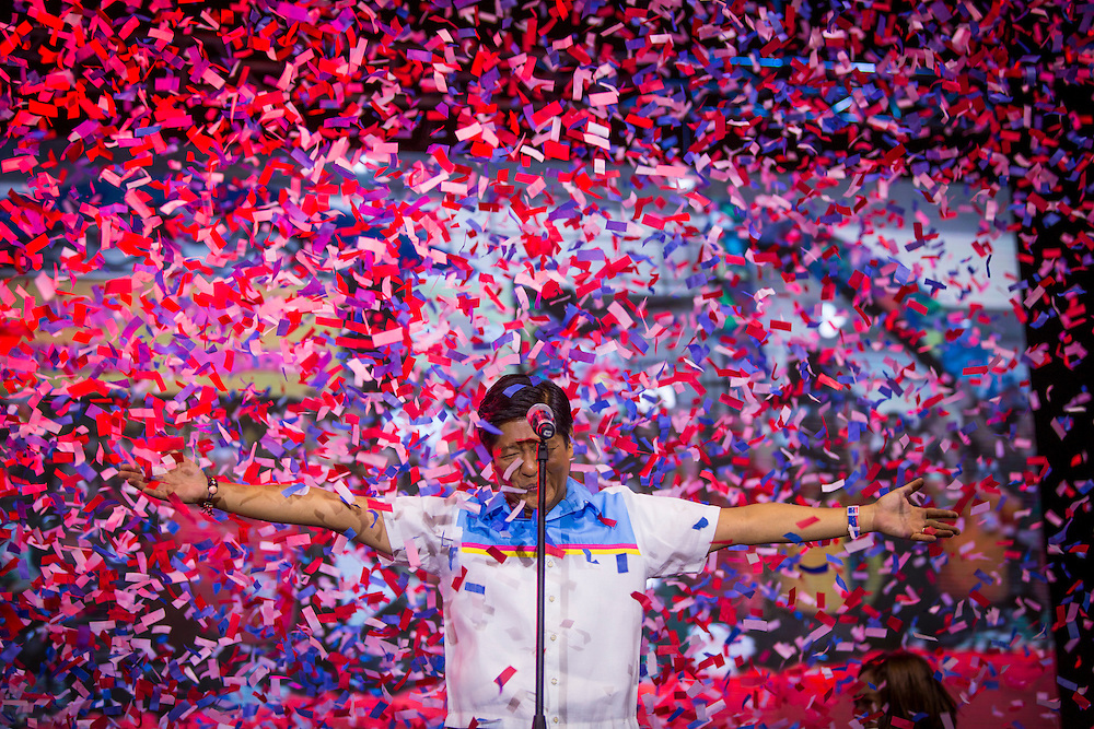 MANILA, PHILIPPINES - MAY 5: Senator Bongbong Marcos raised his two hands filled with confetti before his speech in his meeting de advance in Mandaluyong city, Philippines on May 5, 2016. Bongbong Marcos runs for vice president for the 2016 Philippine national election that  will be held on May 9, 2016.<br /> <br /> Photo by Richard A. de Guzman