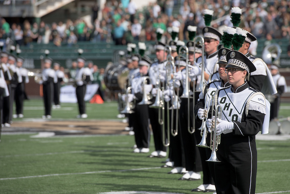 The Ohio University Marching 110 take to the field during the homecoming matchup against Bowling Green at Peden Stadium in Athens, Ohio on Saturday, October 8, 2016.
