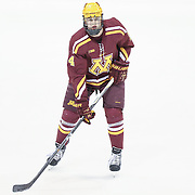 Hudson Fasting #24 of the Minnesota Gophers warms up prior to the game against the Northeastern Huskies at Matthews Arena on November 29, 2014 in Boston, Massachusetts. (Photo by Elan Kawesch)