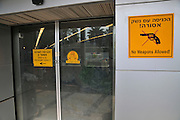 Israel, Ben-Gurion international Airport, No Weapons allowed warning sign in English and Hebrew