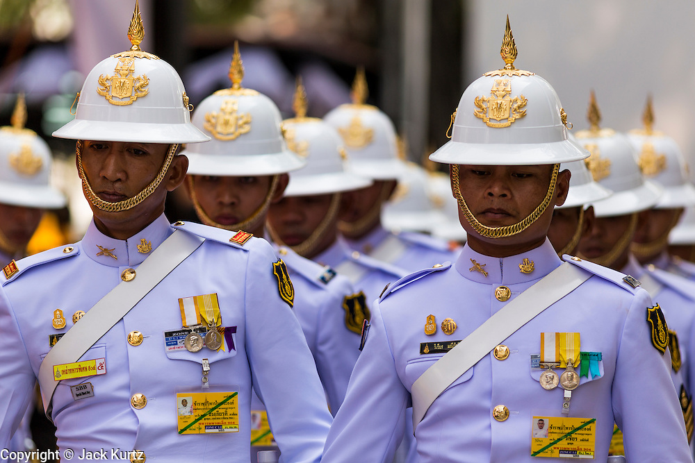 12 DECEMBER 2013 - BANGKOK, THAILAND: Members of the Royal Guards unit of the Thai army march out of mourning service for the Supreme Patriarch at Wat Bowon Niwet in Bangkok. Somdet Phra Nyanasamvara, who headed Thailand's order of Buddhist monks for more than two decades and was known as the Supreme Patriarch, died Oct. 24 at a hospital in Bangkok. He was 100. He was ordained as a Buddhist monk in 1933 and rose through the monastic ranks to become the Supreme Patriarch in 1989. He was the spiritual advisor to Bhumibol Adulyadej, the King of Thailand when the King served as monk in 1956. There is a 100 day mourning period for the Patriarch, the service Thursday, on the 50th day, included members of the Thai Royal Family. Although the Patriarch was a Theravada Buddhist, he was the Supreme Patriarch of all Buddhists in Thailand, including the Mahayana sect, which is based in Chinese Buddhism.     PHOTO BY JACK KURTZ