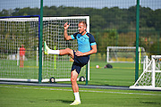 Harry Kane warms up during Tottenham Training Session at Tottenham Training Centre, Enfield, United Kingdom on 13 September 2016. Photo by Jon Bromley.