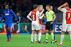 /aj6 and Carel Eiting #8 of Ajax in discuss with referee during the Europa League match R32 second leg between Ajax and Getafe at Johan Cruyff Arena on February 27, 2020 in Amsterdam, Netherlands