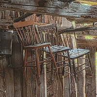 HDR photo of old pasteurizers, chairs and a yoke speak of another era.