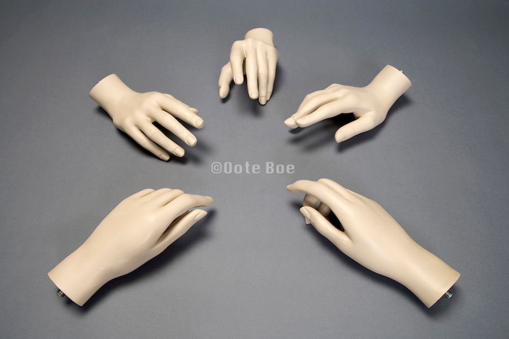 mannequin hands forming a circle