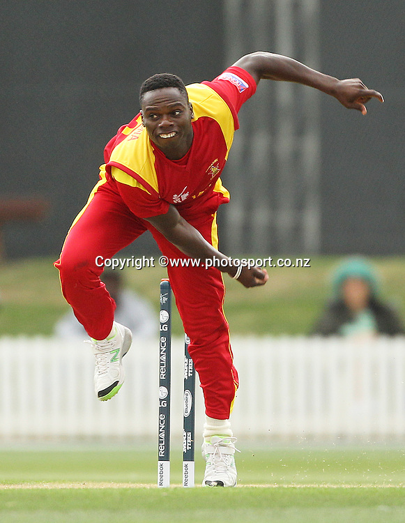 Tawanda Mupariwa of Zimbabwe bowling during the ICC Cricket World Cup warm up game between the Black Caps v Zimbabwe at Bert Sutcjliffe Oval, Lincoln, Christchurch. 9 February 2015 Photo: Joseph Johnson / www.photosport.co.nz