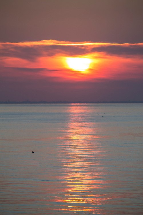 Clouds light up from the sun setting which is reflected in the calm waves of The English Channel from Folkestone Kent, England, United Kingdom. (photo by Andrew Aitchison / In pictures via Getty Images)