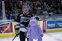KELOWNA, CANADA - DECEMBER 5: Dillon Dube #19 of Kelowna Rockets stands on the ice with a teddy bear after scoring the first goal against the Portland Winterhawks triggering the annual teddy bear toss on December 5, 2015 at Prospera Place in Kelowna, British Columbia, Canada.  (Photo by Marissa Baecker/Shoot the Breeze)  *** Local Caption *** Dillon Dube;