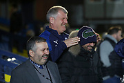 AFC Wimbledon manager Glyn Hodges having some fun and laughing with a fan during the EFL Sky Bet League 1 match between AFC Wimbledon and Ipswich Town at the Cherry Red Records Stadium, Kingston, England on 11 February 2020.