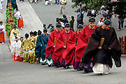 Shinto priests climbing the stairs to the main shrine for the main ceremony, during the second day of the 3-day anual festival of Tsurugaoka Hachimangu Shrine in Kamakura.