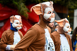 © Licensed to London News Pictures. 07/12/2019. LONDON, UK.  7 December 2019.  Participants dressed in Gremlins costumes prepare to take part in The 39th Great Christmas Pudding Race in Covent Garden, raising funds for Cancer Research as well as having lots of festive fun.  Photo credit: Stephen Chung/LNP