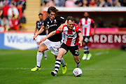 Jake Taylor (25) of Exeter City battles for possession with Alex Woodyard (30) of Lincoln City during the EFL Sky Bet League 2 match between Exeter City and Lincoln City at St James' Park, Exeter, England on 19 August 2017. Photo by Graham Hunt.
