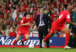 CARDIFF, WALES - Wednesday, September 8, 2004: Wales' manager John Toshack MBE looks on as Jason Koumas storms forward Northern Ireland during the Group Six World Cup Qualifier at the Millennium Stadium. (Pic by David Rawcliffe/Propaganda)