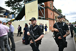 © Licensed to London News Pictures. 19/06/2018. London, UK. Armed police at Day one of Royal Ascot at Ascot racecourse in Berkshire, on June 19, 2018. The 5 day showcase event, which is one of the highlights of the racing calendar, has been held at the famous Berkshire course since 1711 and tradition is a hallmark of the meeting. Top hats and tails remain compulsory in parts of the course. Photo credit: Ben Cawthra/LNP