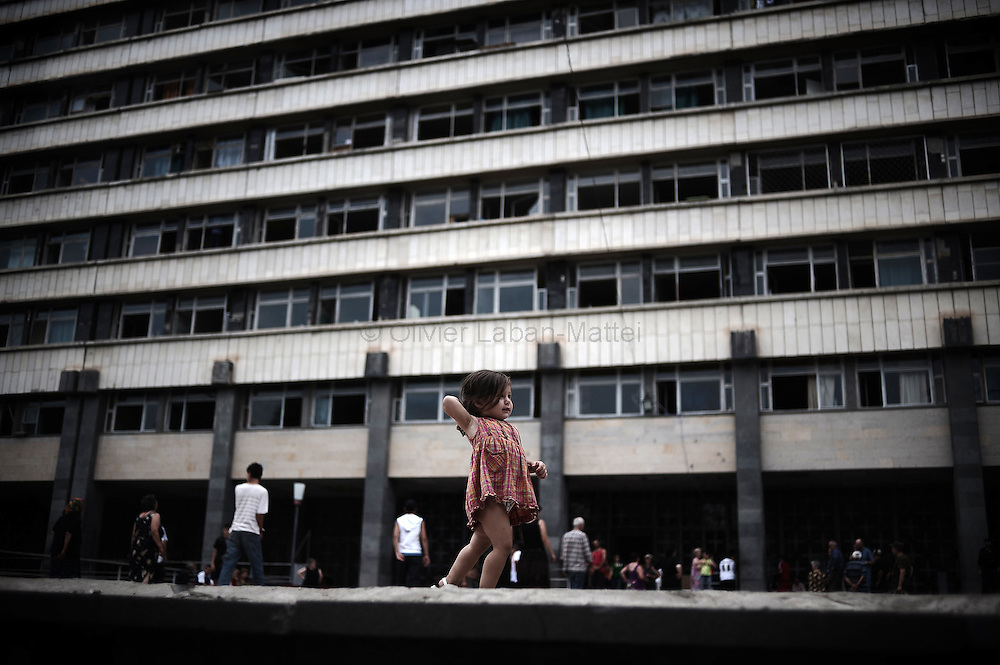 A young Georgian girl who fled her village after a Russian attack plays in front of the former Russian Ministry of Justice on August 29, 2008 in Tbilisi. Russia is facing an avalanche of criticism from the West over its decision to recognise the independence of two Georgian secessionist regions at the heart of the conflict: South Ossetia and Abkhazia.