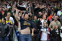 Swan City fans sing during the game. - Photo mandatory by-line: Alex James/JMP - Tel: Mobile: 07966 386802 03/11/2013 - SPORT - FOOTBALL - The Cardiff City Stadium - Cardiff - Cardiff City v Swansea City - Barclays Premier League