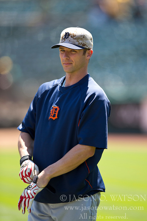 OAKLAND, CA - MAY 26:  Andrew Romine #27 of the Detroit Tigers looks on during batting practice before the game against the Oakland Athletics at O.co Coliseum on May 26, 2014 in Oakland, California. The Oakland Athletics defeated the Detroit Tigers 10-0.  (Photo by Jason O. Watson/Getty Images) *** Local Caption *** Andrew Romine