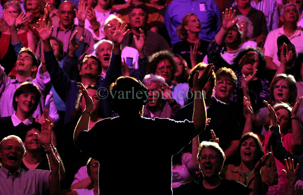 March 12th 2006. New Orleans, Louisiana. <br /> Praising the Lord. A capacity crowd prays, raises hands to God and waits for the Rev Billy Graham to take the stage. Claiming this to be his last event preaching from the pulpit, the world's most famous evangelist, The Reverend Billy Graham later addressed a capacity crowd at the New Orleans Arena as he brings his 'Celebration of Hope' weekend event to an end.<br /> Photo&copy;; Charlie Varley/varleypix.com
