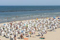 Many traditional Strandkorb beach chairs on beach at Sellin resort on  Rugen Island , Mecklenburg-Vorpommern Germany