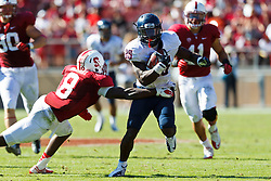 PALO ALTO, CA - OCTOBER 06: Running back Ka'Deem Carey #25 of the Arizona Wildcats is tackled by safety Jordan Richards #8 of the Stanford Cardinal during the fourth quarter at Stanford Stadium on October 6, 2012 in Palo Alto, California. The Stanford Cardinal defeated the Arizona Wildcats 54-48 in overtime. (Photo by Jason O. Watson/Getty Images) *** Local Caption *** Ka'Deem Carey; Jordan Richards