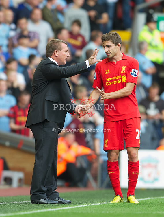 LIVERPOOL, ENGLAND - Sunday, August 26, 2012: Liverpool's manager Brendan Rodgers and Fabio Borini during the Premiership match against Manchester City at Anfield. (Pic by David Rawcliffe/Propaganda)