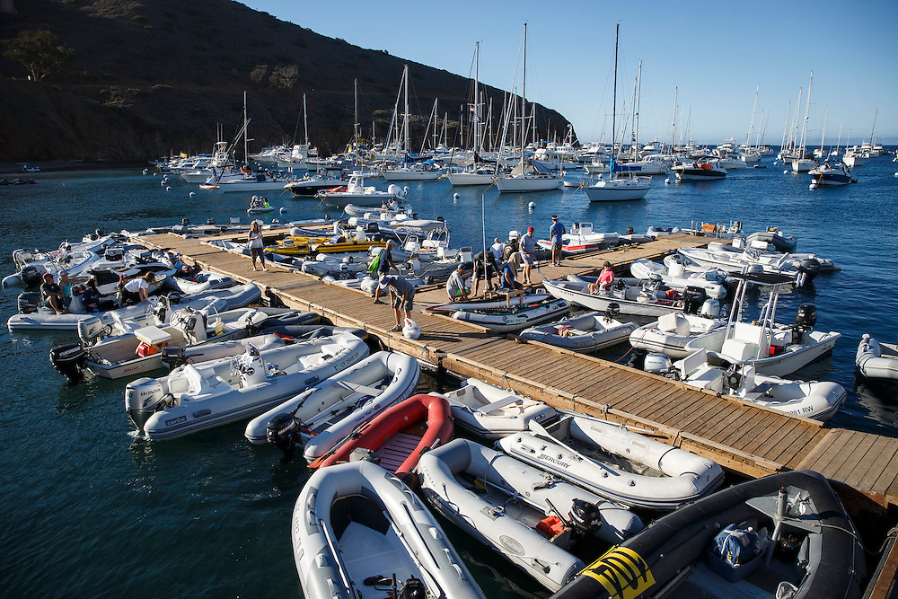 Dinghy boats surround the dock at Two Harbors before the Catalina Classic Paddle board race between Two Harbors and the Manhattan Beach Pier on Saturday, August 29, 2015 in Two Harbors, Calif.  Paddlers start from Two Harbors on Catalina Island, traveling 32 miles through the Pacific Ocean in an endurance feat to end at the Manhattan Beach Pier. © 2015 Patrick T. Fallon