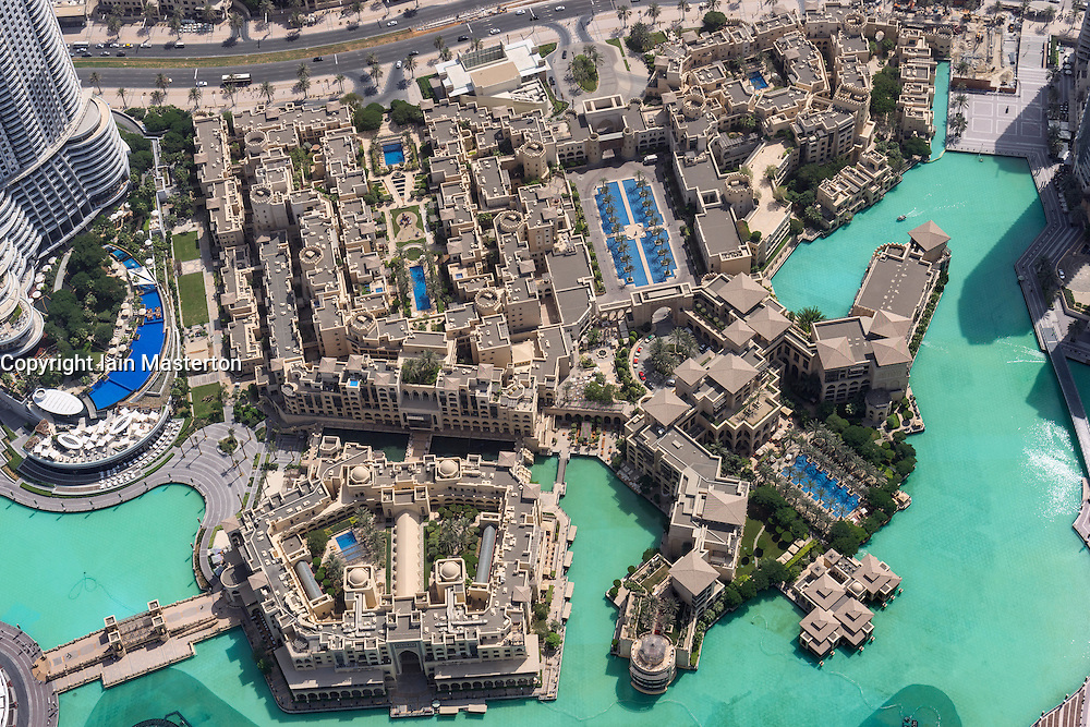 Looking down on luxury housing and retail buildings  at Souk al Bahar next to lake at Burj Khalifa in Downtown Dubai United Arab Emirates