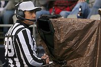 Referee Tony Corrente waits for the video replay to cue up for a review on a play. Arizona Cardinals vs. Seattle Seahawks at Qwest Field in Seattle on Sunday Dec. 26, 2004. Photo by Kevin P. Casey/WireImage.com